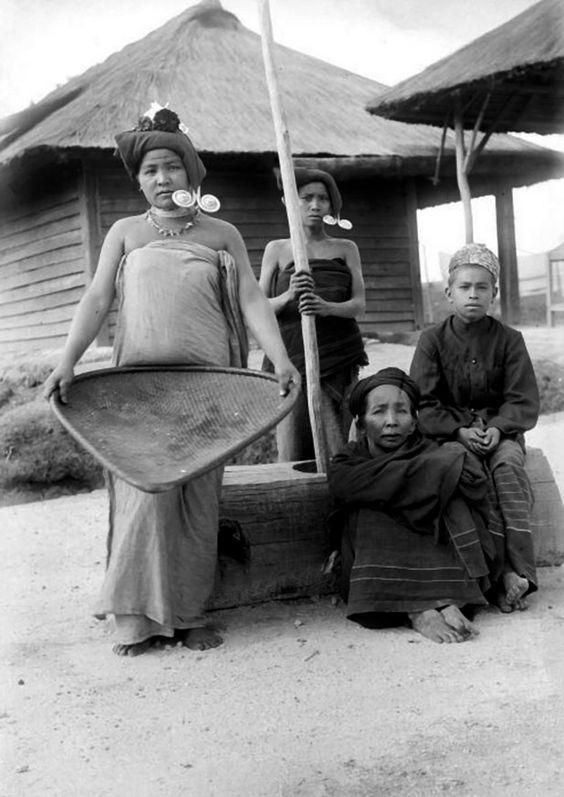 Karo Batak women winnowing and pounding rice, North Sumatra. Date unknown.