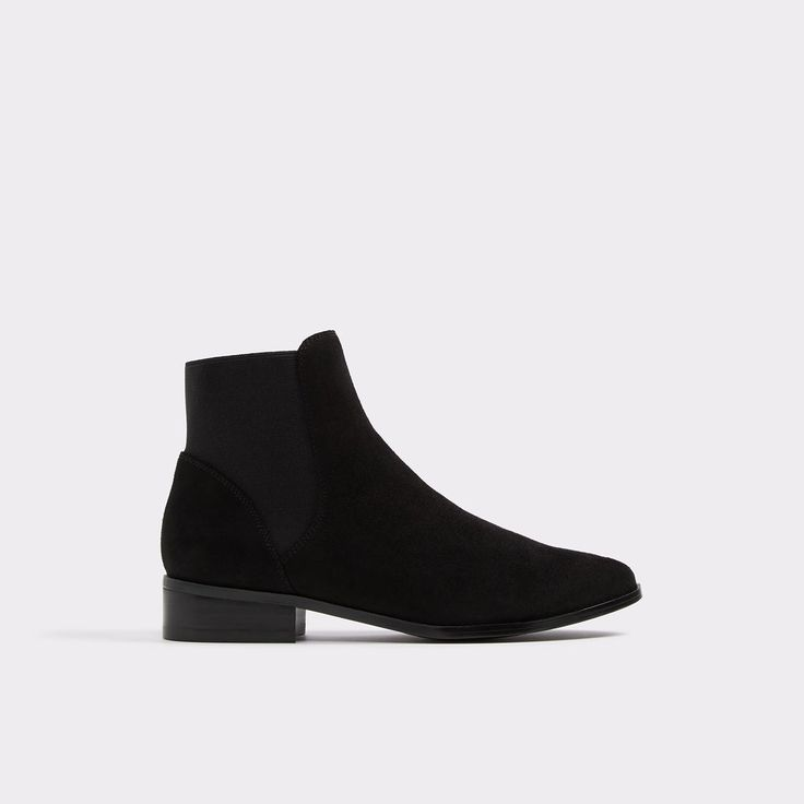 Nydia You will turn heads in our charming flat booties. Elastic sides make them easy to slip on and off on a busy day.