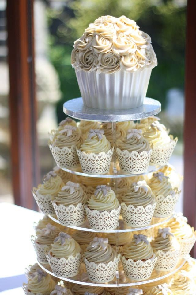 """If you are going to do this make sure the top """"cupcake"""" is built like a cake tier and not a cupcake. If not the frosting will be too heavy and it will lose shape. Giant cupcake tower. Wedding Cake by Jane Rose Cakes. Baked on Anglesey in North Wales. www.janerosecakes.com"""