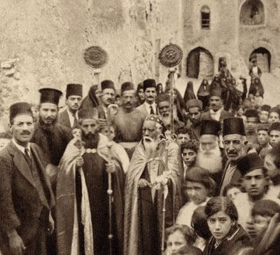 Celebration at the Syriac Orthodox Monastery in the Iraqi northern city of Mosul. Late-Ottoman era, early 20th c.  The Syriac Christians ,known locally as Syriaan.Their liturgy is Syriac, a dialect of Aramaic. The seat of the Patriarch was at the Safron Monastery , known as Qasr al Za'faran,located few miles east of the ancient city of Mardin  (in south-east Turkey).