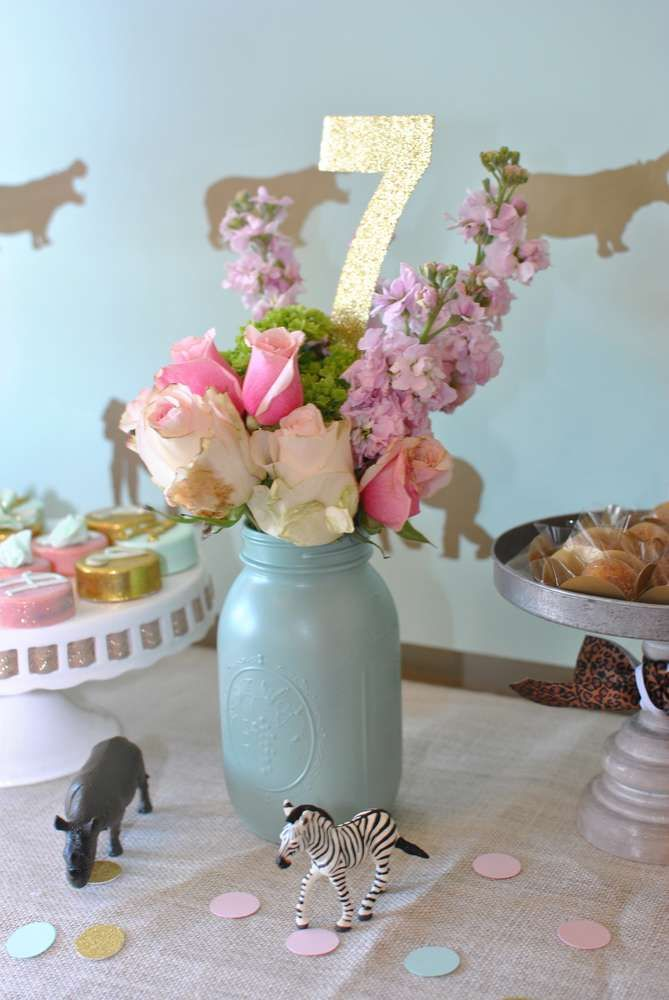 Mason jar flower arrangement at a safari birthday party! See more party planning ideas at CatchMyParty.com!