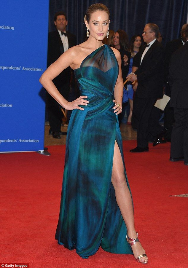 Hannah Davis brings glamour to White House Correspondents' dinner in iridescent blue and green gown
