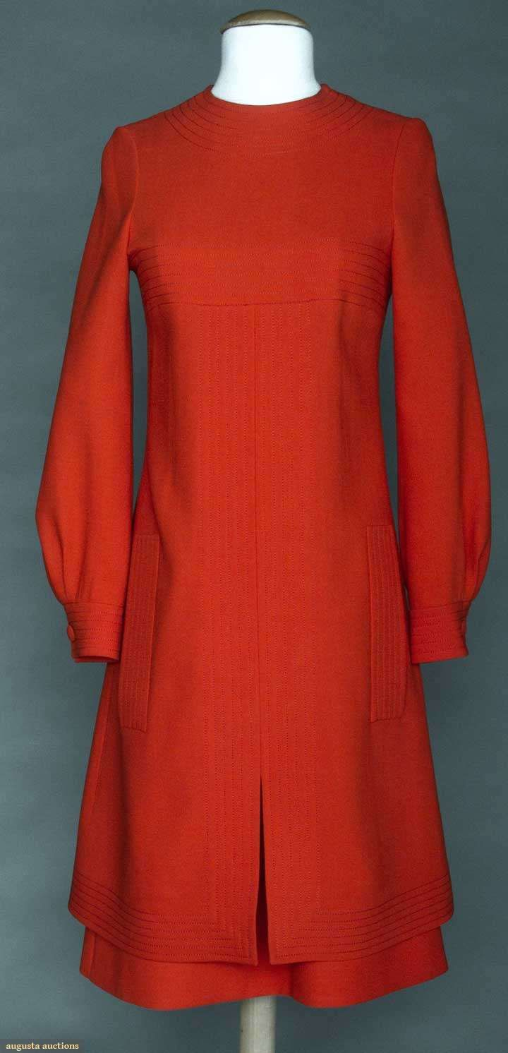 "Pierre Cardin Wool Day Dress, 1970s, Augusta Auctions -- Tomato red, long sleeves, channel quilted details throughout, faux pocket flaps, CF slit, back w/ curved overpanel & CB bow, label ""Pierre Cardin Boutique Paris"", B 34"", L 40"", excellent. Provenance: mme. Erna de Paz, Argentine & Parisienne socialite & friend of Msr. Cardin."