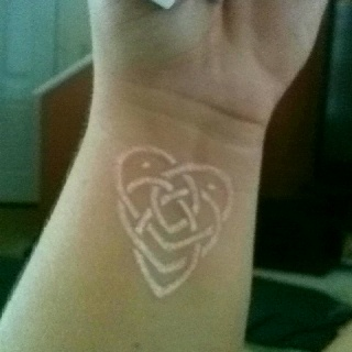 White ink tattoo of Celtic motherhood knot... I see this in my not so distant future!!!!