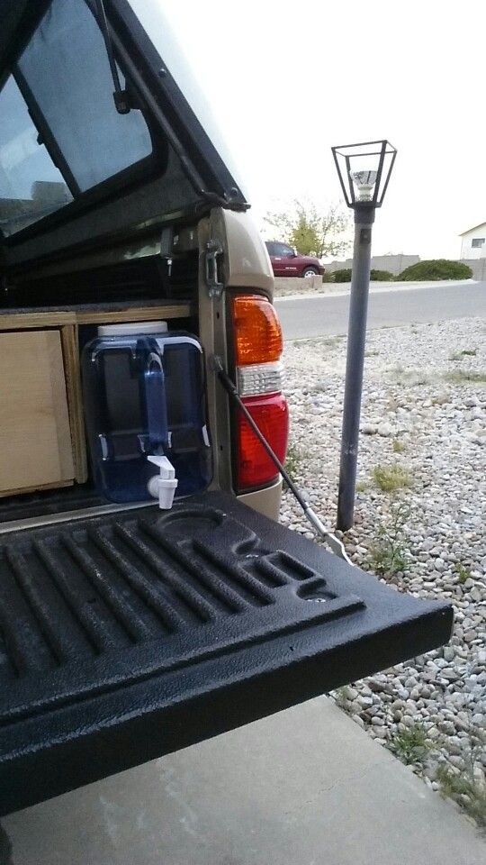 My truck build. 2004 Toyota Tacoma 4x4, manual transmission regular cab. Does great on gas mileage, and all gear stows away neatly under the bed. Water for drinking, the dog and washing hair.