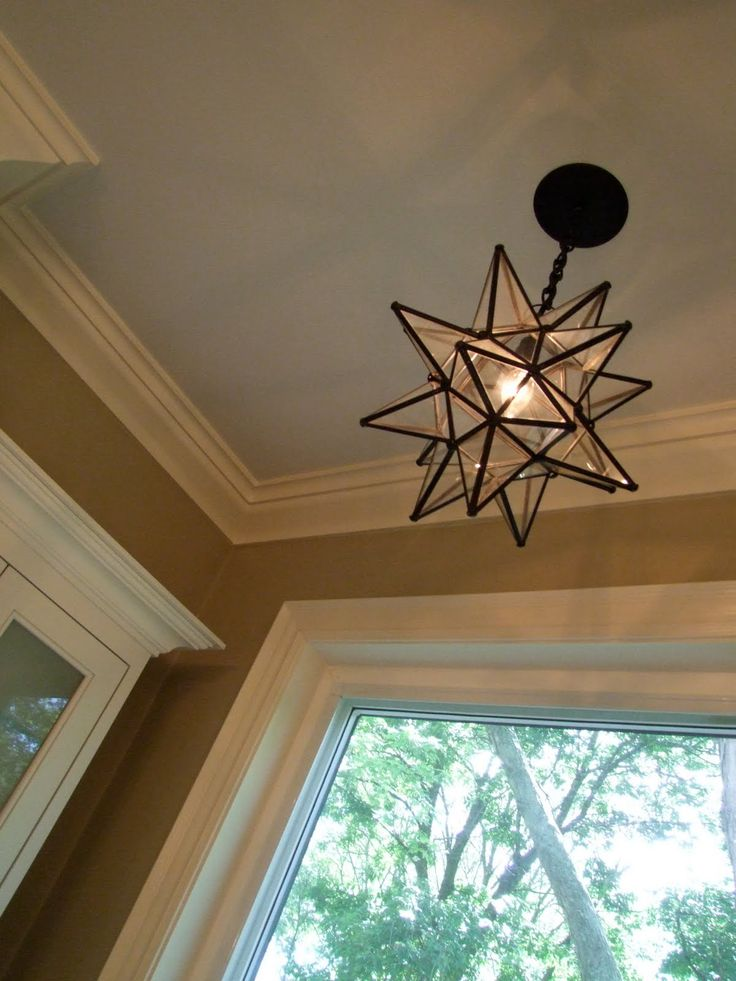 Moravian Star light fixture Outside the laundry room/garage door area