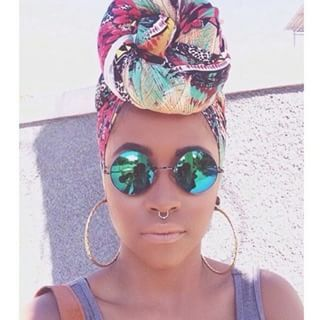 A colorful turban is a trendy statement and the answer to giving your hair a break. | 15 Protective Styles When Cornrows Just Won't Do