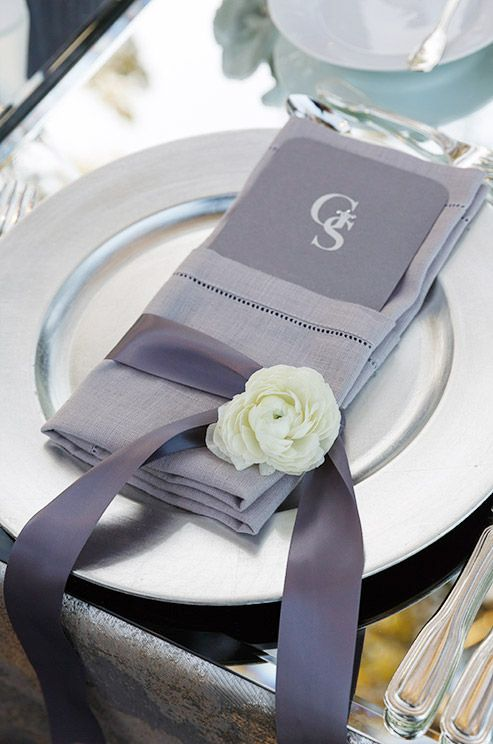 Sweet ribbon and flower details on the gray linen napkins.