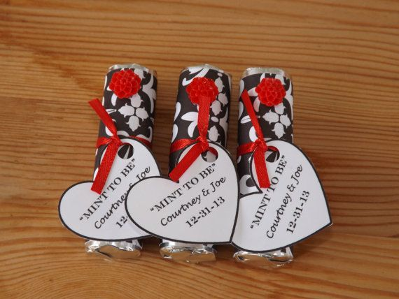 Mint to be... Wedding favors but with a black flower and white ribbon...