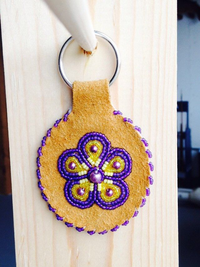A personal favorite from my Etsy shop https://www.etsy.com/listing/274270016/purple-and-yellow-flower-key-chain