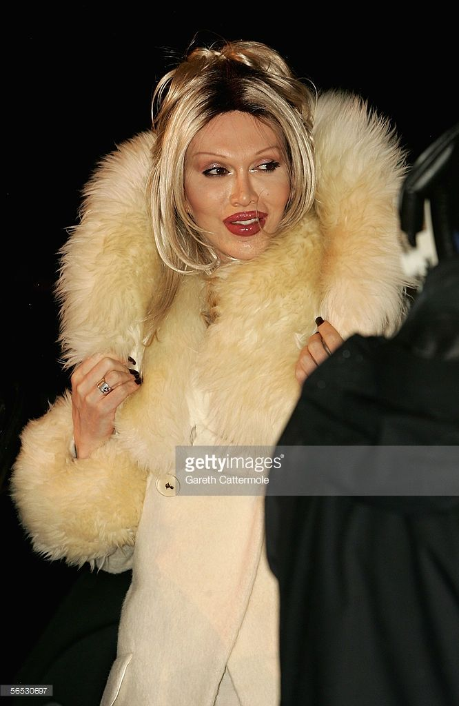 Pete Burns poses for photographers while enters the new Celebrity Big Brother house for the new series of the reality TV show, in Borehamwood on January 5, 2006 in Hertfordshire, England. The popular reality series sees eight celebrities spend two weeks inside Channel 4's Big Brother House, with celebrities being evicted one by one until a winner is announced.