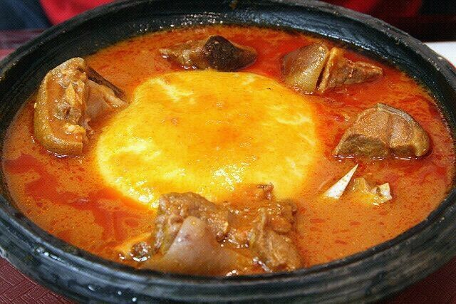 Fufu and meat soup. You're supposed to eat it with your hands. As a Ghanaian I enjoy eating this food.