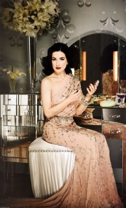 Dita going all diva at her dressing table.