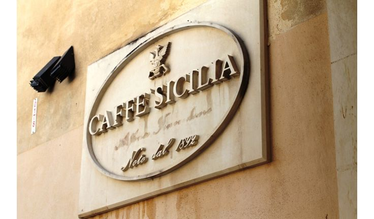 Caffè Sicilia ~  Expect the unexpected at Caffe Sicilia, where chef Corrado Assenza gives basil new meaning as gelato, or you might find yourself savoring almond-milk granita with the fashion designer Giorgio Armani at the next table. Assenza has become a pioneer among Italian chefs for his cold patisserie creations and the way he mixes sweet and sour ingredients. #Sicily #Noto #Corrado_Assenza #Caffe_Sicilia