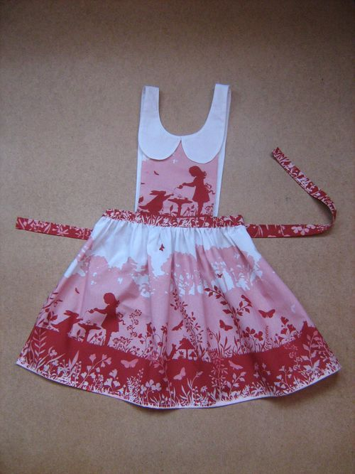 This adorable apron is obviously a tribute to Alice in Wonderland ~ The fabric panel used with the Alice scene on it is called: Alice Tea time & if I have translated the French blog I located it on. ~ ♥