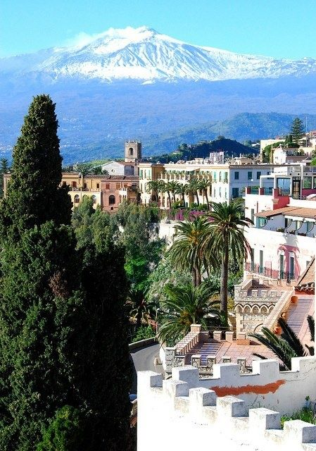 Mt. Etna towering over Taormina, Sicily, Italy.
