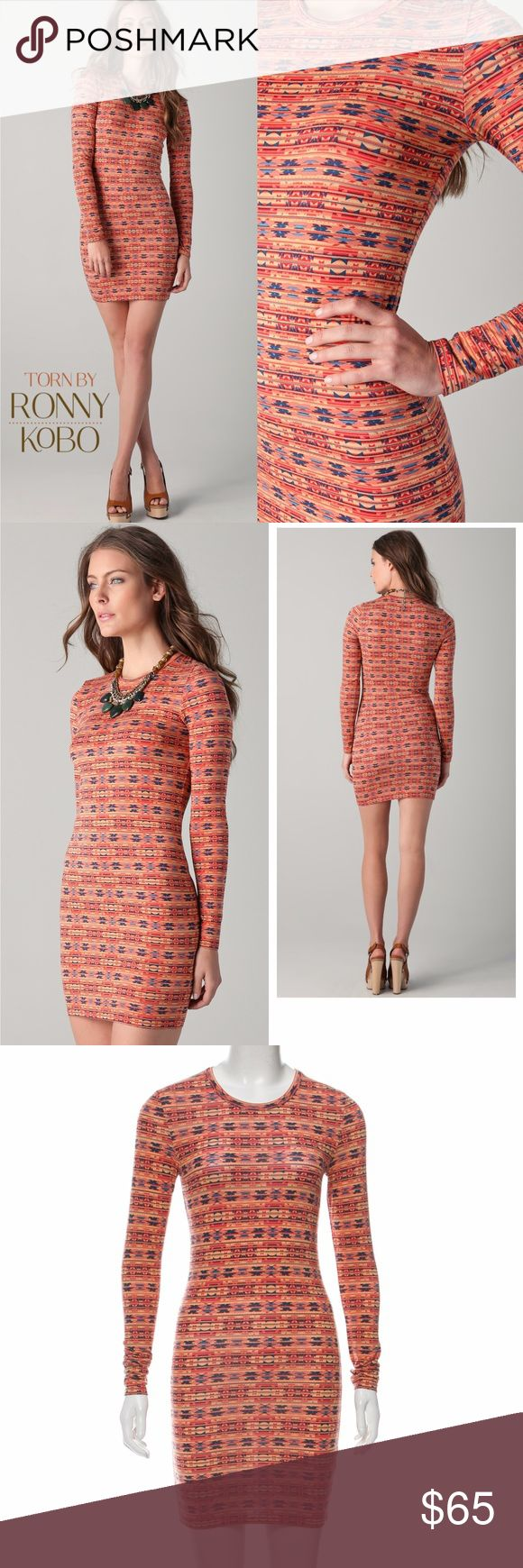 """NWT Torn by Ronny Kobo Patterned Bodycon Dress New with tags. Torn by Ronny Kobo Zoe Extra Small Azi Long Sleeve Dress in red/orange with blue and yellow abstract print. This print jersey dress features a crew neck and long sleeves. Measures 31"""" long with approximate waist size of 26"""". 92% Modal, 8% Spandex. Wash cold and lay flat to dry. Torn by Ronny Kobo Dresses Long Sleeve"""