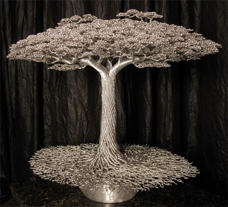 Beautiful tree sculptures created by Kevin Iris out of aluminum alloy wire.via http://www.toxel.com/inspiration/2012/03/05/wire-trees/
