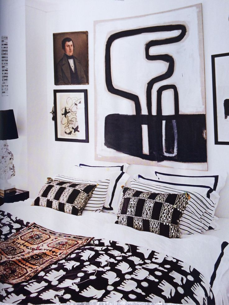 Malene Birger interiors collection / bedroom in b&w / abstract art/ gallery wall