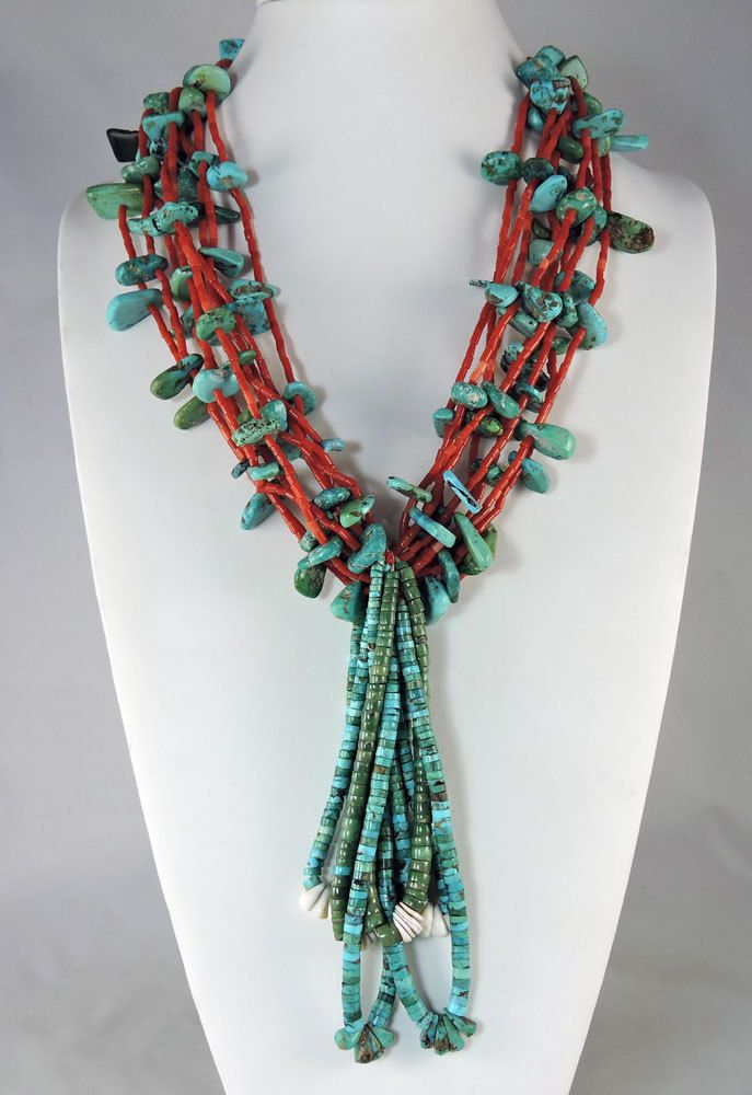 Nine strands of Mediterranean coral are the setting for the mixed turquoise nuggets and tabs, mostly Fox Mine, pump drilled.
