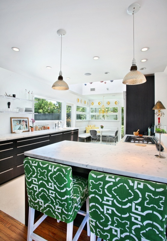 I love the patterned chairs with the subdued kitchen.
