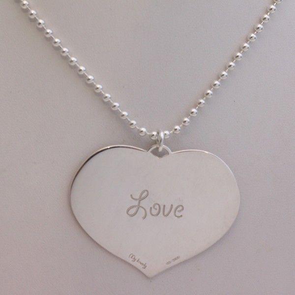 """Collana con catena a palline in argento 925 e ciondolo a cuore con inciso """"Love"""". La catena è lunga circa 40 cm indossata. Il ciondolo è spesso 1mm, è alto circa 3.5cm e lungo circa 4.5cm. Silver 925 beads chain necklace with heart charm engraved """"Love"""". Necklace is long about 40cm worn, pendant is deep about 1mm, high about 3,5cm and long about 4,5cm."""