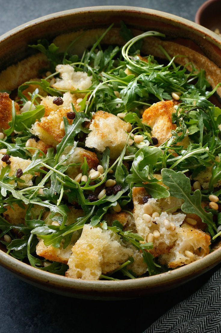 """NYT Cooking: This is, quite possibly, the bread salad to end all bread salads. Judy Rodgers, the legendary chef and bread lover, developed it to serve alongside <a href=""""http://cooking.nytimes.com/recipes/1015770-zuni-cafe-chicken"""">roast chicken</a>, but it's perfect paired with any roast meat. Bread chunks are mixed with a sharp vinaigrette, softened currants, toasted pine nuts and lightly cooked scall..."""
