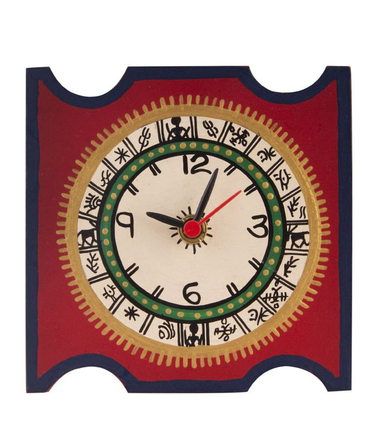 This red handprinted warli table clock will definitely take you back to the ethnic era. The edges and middle of the clock is careful painted with multiple colors to give a class and sheen. This table clock will definitely accentuaute the beauty of your table. This clock can be placed at an angle on table as it comes with a stand