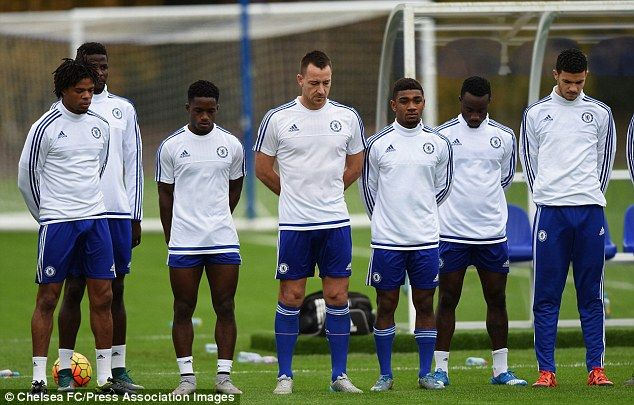 Terry (centre) and his Chelsea team-mates observe a two-minute silence to mark Armistice D...