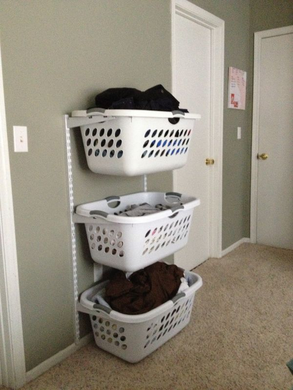 Back-saver: laundry baskets off floor, out of way, at waist level, too, for grabbing fresh laundered hangables.