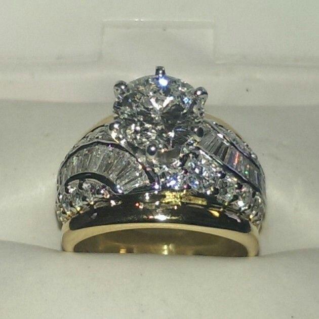 4 carat diamond engagement ring set in 14 karat yellow and white gold