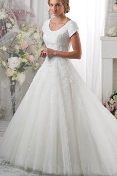 Add long sleeves, higher neck line and a jeweled belt. Classic Tulle Short Sleeves Princess Modest Wedding Dress with Lace