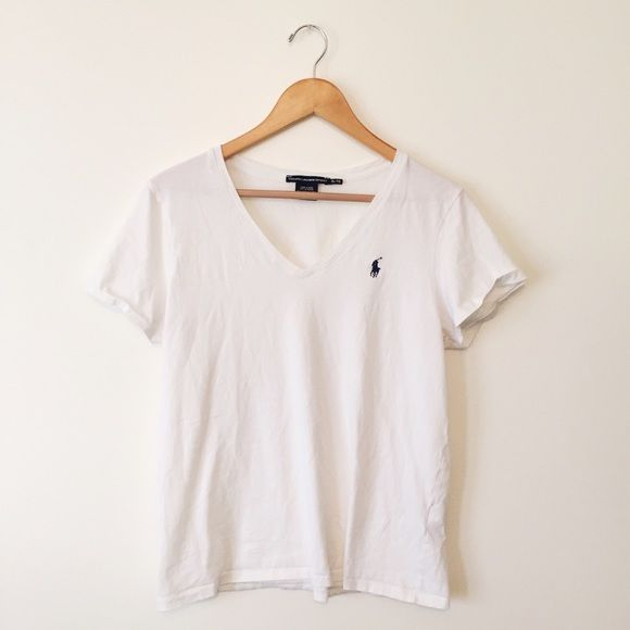 Polo Tee Shirt Women's White V-Neck Polo Tee Shirt with a Navy Blue Logo accent. This shirt is originally an XL, But I sized it a Medium because Polo runs small and I shrunk it in the wash. Great quality, no flaws. Polo by Ralph Lauren Tops Tees - Short Sleeve