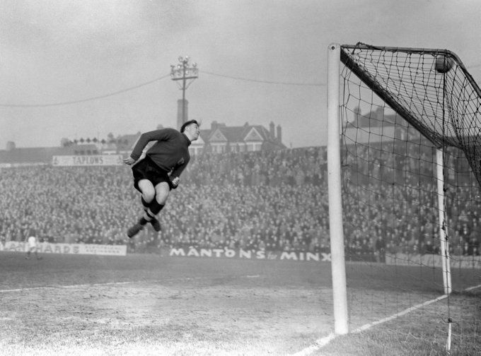 Bishop Auckland goalkeeper Harry Sharratt stops Crook Town from scoring during the FA Amateur Cup Final at Newcastle's St James' Park, 1954