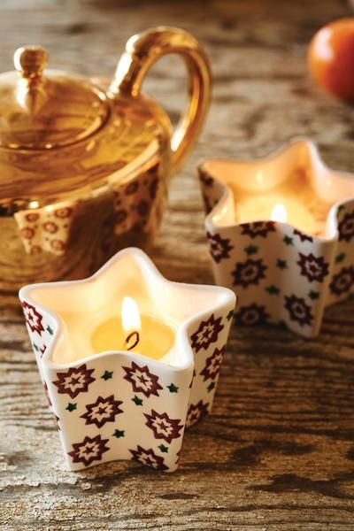 Lovely Emma Bridgewater star shaped filled candle holder which has been hand stencilled and smells gorgeous and would look lovely on a dresser or in a window. Size: H 6cm x 8cm Matterial: Pottery