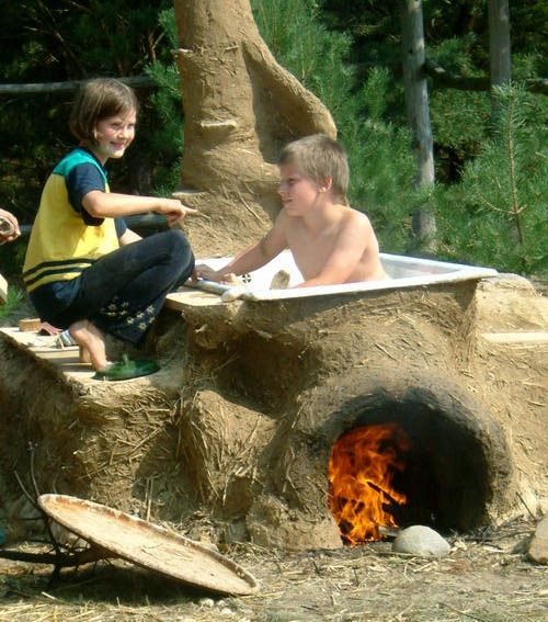 Paulina Wojciechowska creates earth-made homes and items such as this outdoor tub. But an outdoor oven is more realistic in my case.