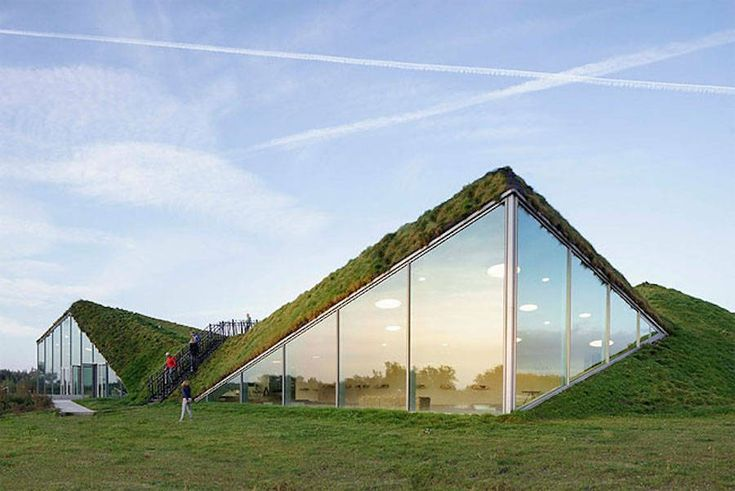 Museum covered in Grass in Netherlands  After being redesigned by Studio Marco VermeulenBiesbosch Museum in Werkendam Netherlands opened to the public last summer. Covered in grass the hexagonal structure is shaped by a group of little pyramids featuring large bay windows and a path on top of the museum to walk through the green roof. Photos by Ronald Tilleman.            #xemtvhay