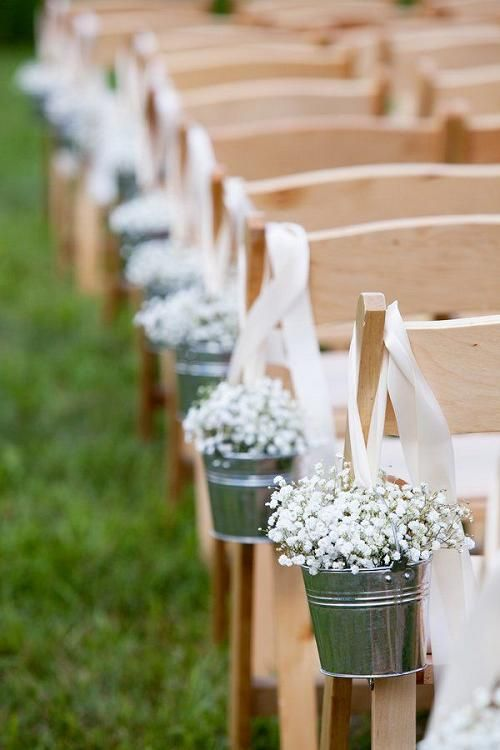 rustic baby's breath' flowers wedding chair decor / http://www.deerpearlflowers.com/rustic-buckets-tubs-wedding-ideas/2/