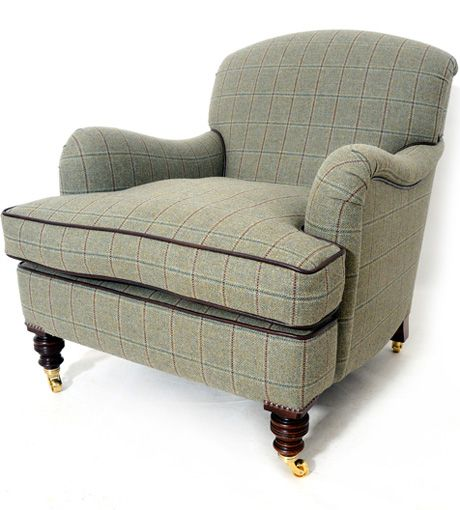 Covered in 7 metres of a Johnstons of Elgin tweed with a brown leather piping. In the base of the chair we have used hand tied double cone seat springs with mahogany legs and brass castors. http://www.petersilk.co.uk/product.php/502/handmade-copy-of-original-howard-sons-easy-chair