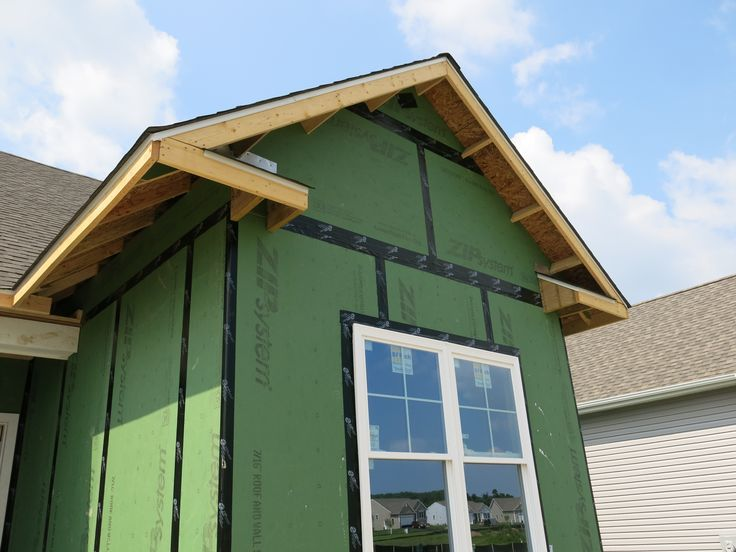 The zip wall system makes sheathing the house quick and for Exterior wall sheeting