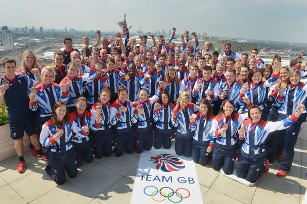 Great Britain's medal winners pose on the roof of Team GB House in Stratford.