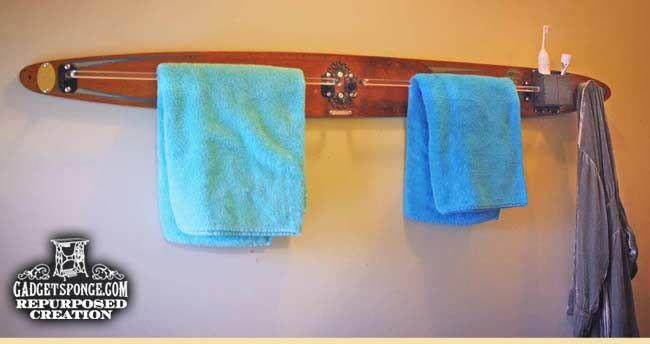 Repurposed vintage water ski as a towel and robe rack