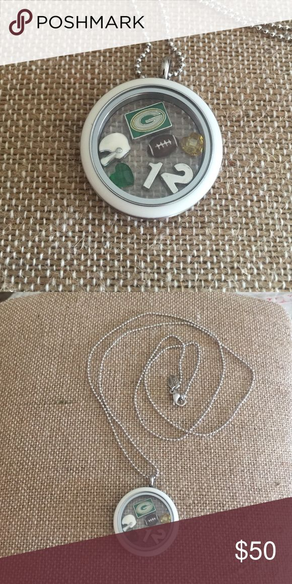 "NWT Origami Owl twist locket, chain, charms This is a new Origami Owl locket with white twist face, 30"" ball chain, football, helmet, yellow & green crystal heart, 12, and Green Bay Packers emblem. (All items are Origami Owl EXCEPT GB emblem & 12.) Origami Owl  Jewelry Necklaces"