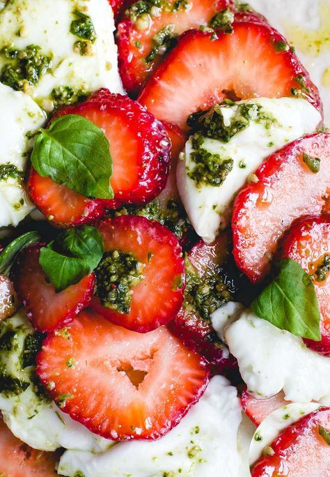 A tomato-less pesto caprese salad with juicy summer strawberries  & fresh mozzarella. Refreshing & flavorful with just 4 ingredients, naturally gluten-free.