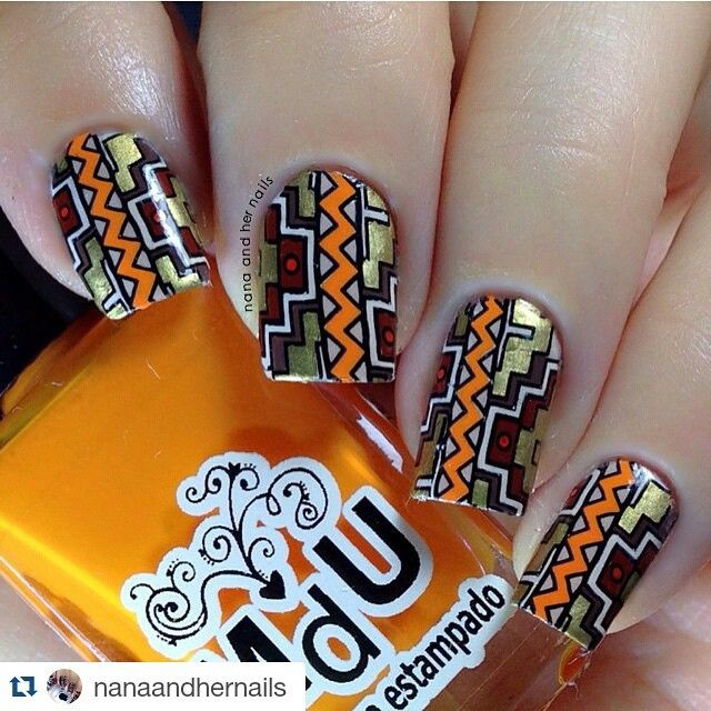 #Repost @nanaandhernails ・・・ Tribal nails for #glamnailschallenge  YYYasshh ! Finally i have a chance to use my lovely @emilydemolly #EDM11 . Products used : @mundodeunas 'Black' , 'brown' , 'chocolate' , 'gold' , 'sunflower'  yeah i know i basically do this whole nail with stamping polish but thats how i usually do to make the color so vibrant  @messymansion 'medium soft stamper'  the best stamper i have tried so far  @urbannailart 'SPEED-UP' fast drying top coat