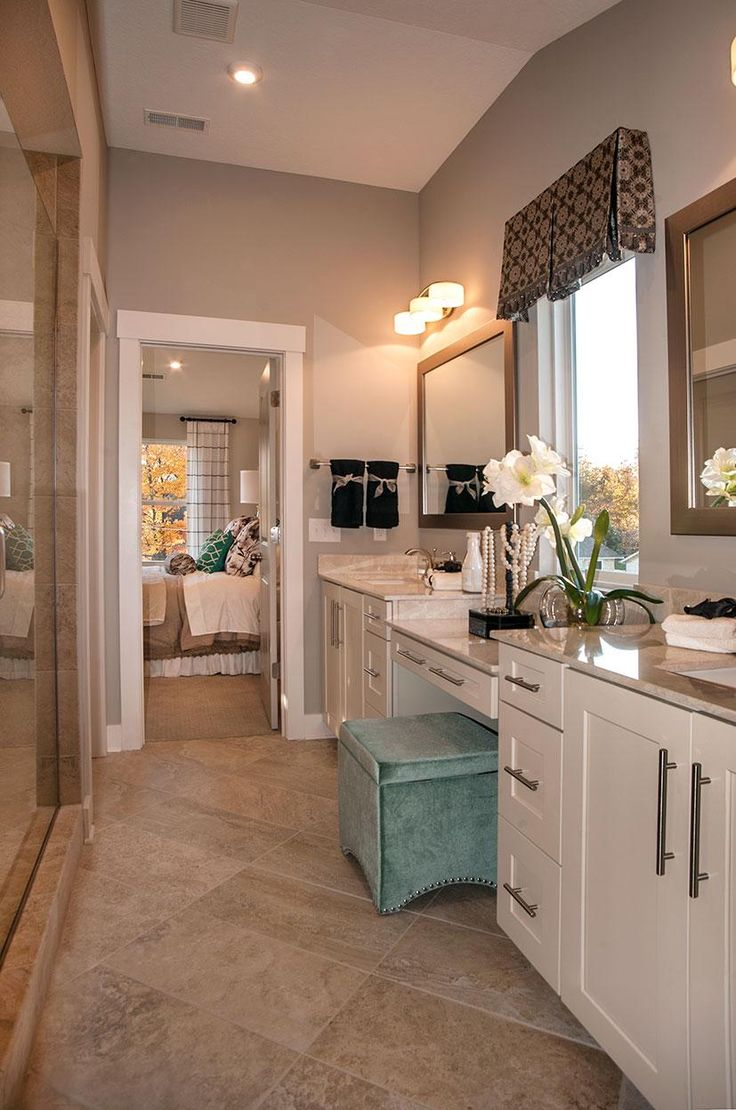 Master Bathroom With White Cabinets Dual Vanities And