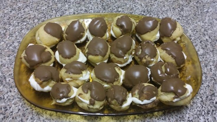 Yummy Eclairs :)  * Center filled with caramel, bannana, cream and topped with cadbury chocolate. Yum