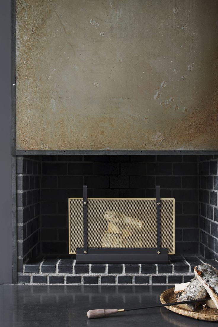 Fireplace screen Emma Doré - designed by Swedish designer Emma Olbers, made in France.  Powder coated metal with brass details.