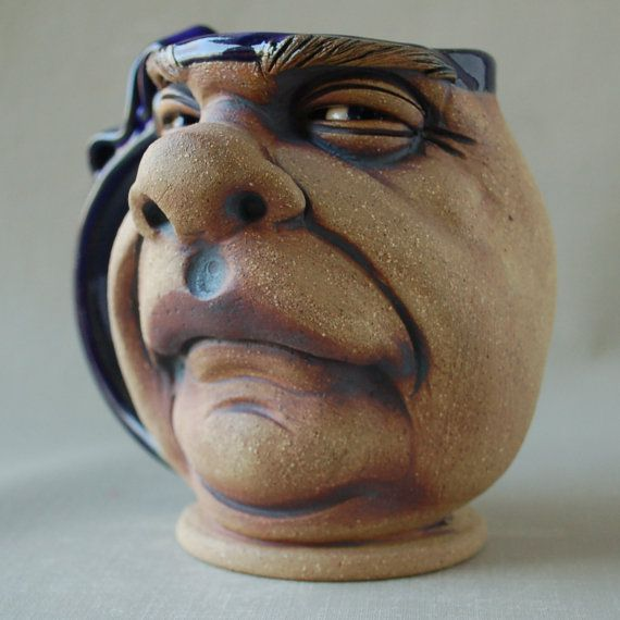 Bull a wheel thrown one of a kind face mug by Herksworks on Etsy, $40.00