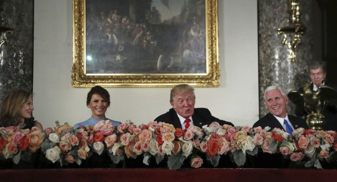 President Donald Trump with his wife Melania Trump, second from left, Vice President Mike Pence, right, and Sen. Roy Blunt, R- Mo., right, and his wife Abigail Perlman, left, laugh during the inaugural luncheon on Capitol Hill on Jan. 20.